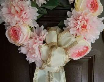 Floral wreath with pink peonies and glitter bow