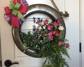 Adorable spring,summer,tire floral,floral arrangement,everyday,front door decor,wall decor.