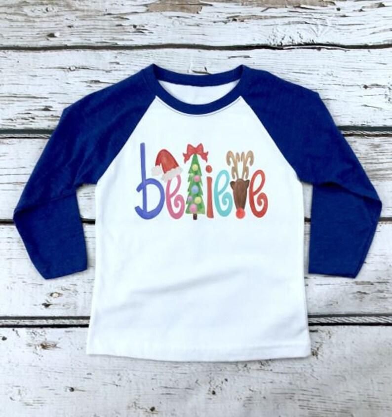 14868ad7c3253f Believe Christmas Raglan l Christmas Shirt l Personalized   Etsy