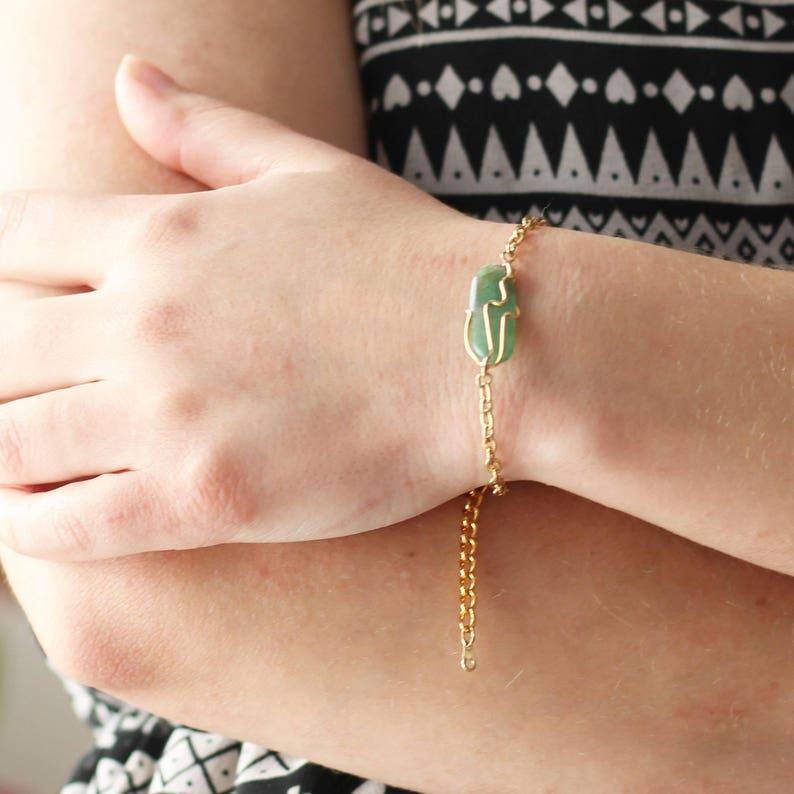 Gold bracelet for her with a green gemstone