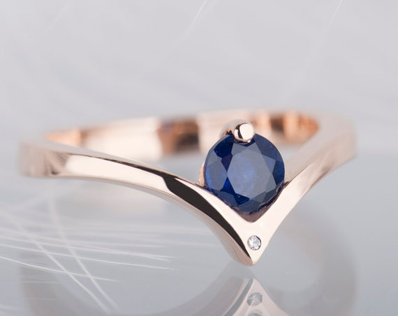 14K rose gold blue sapphire and diamond engagement ring