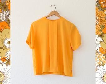 apricot orange blouse with stripe