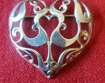 very nice ornate sterling silver pin