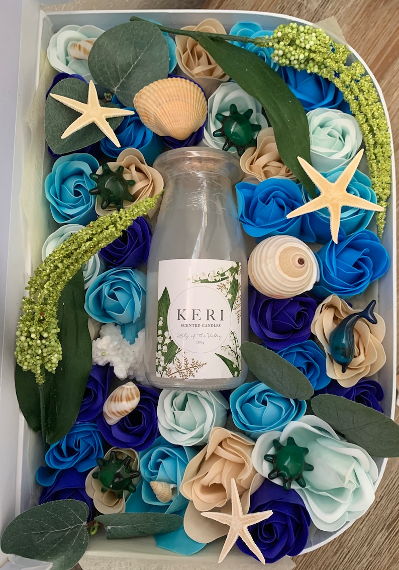 Soap Flowers in a blue suitcase beach theme with candle image 0