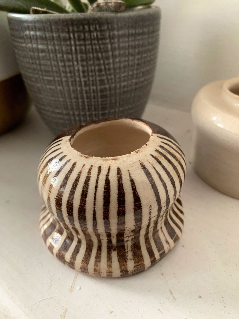 Small hand thrown stonewear ceramic vase in chocolate brown and striped pattern
