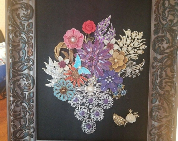 Vintage and modern jewelry art framed. Beautiful floral bouquet
