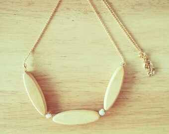 Natural wood and gold bib necklace