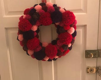 Large round pompom wreath in shades of red