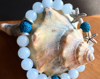 Aromatherapy diffuser bracelet, AAA aquamarine gemstones, silver starfish, teal lava stone beads, use with essential oils