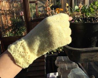 Women's yellow hand knitted fingerless gloves