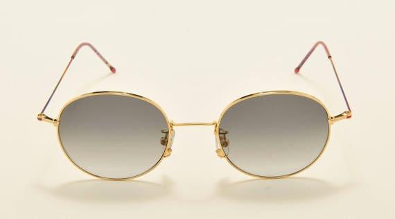 Organix 802 round shape / titanium golden frame / 90s model / NOS / Made in Japan / new lenses / Vintage sunglasses