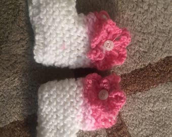 Pink baby booties with flowers