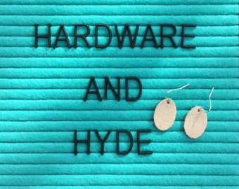 Off-White suede leather oval earrings with silver tone hardware