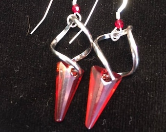 Swirl & Spike red magma swarocski crystal focals with twisted silver fixtures and reiterated swarovski red magma crystal on earwire