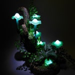 Mushroom lamp consisting of six turquoise mushroom lights which give a magic athmosphere if used as room lighting