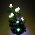 Mushroom lamp consisting of six white mushrooms lights which can be used as bedside lamp or as a centerpiece