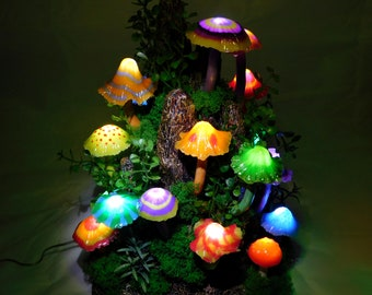 Mushroom lamp consisting of twenty luminous mushrooms in different shapes and colors