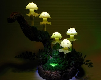 Mushroom lamp consisting of five light yellow mushroom lights which give a magic athmosphere if used as room lighting