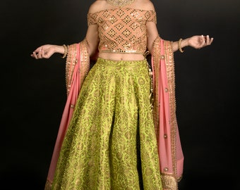 6efc308f Green silk lehenga with blouse in authentic poly dupion silk in lovely  peach color with beige color thread embroidery and mirror work.