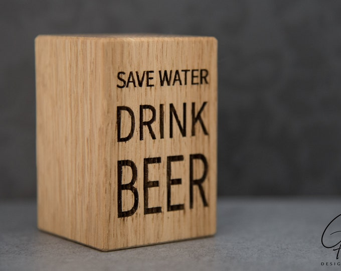 Beer opener with a slogan (Save water drink beer)