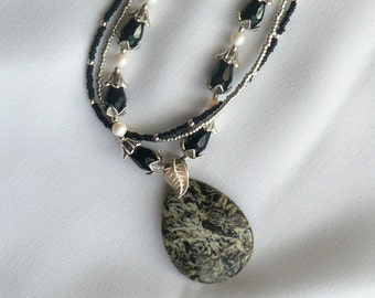 Pendant black natural stone and Swarovski pearl and silver necklace.