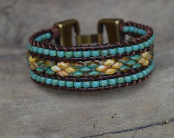 Kwaye. (Beads and leather cuff bracelet.)