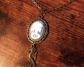 Seahorse and skeleton cameo necklace