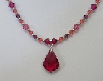 Irresistible Swarovski crystal baroque pendent necklace set in raspberry.