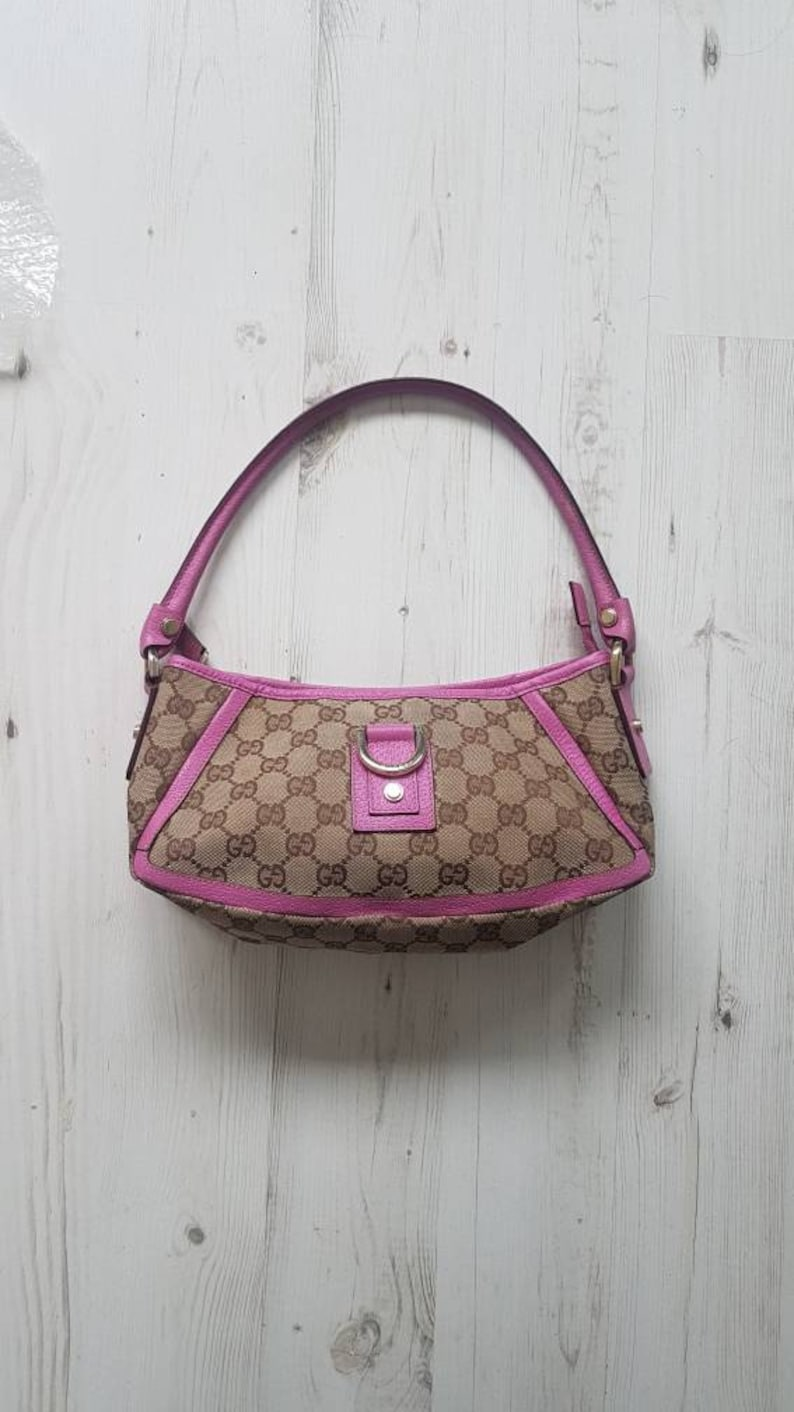 93ed5300ffc Gucci classic monogram canvas with pink leather trim. Vintage