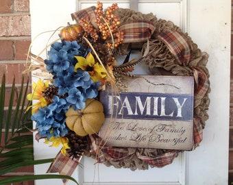 Burlap wreath, teal hydrangea and yellow sunflowers, pumpkins,