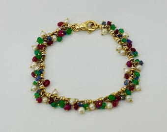 Vintage 18ct.gold pearl and gemstone bracelet