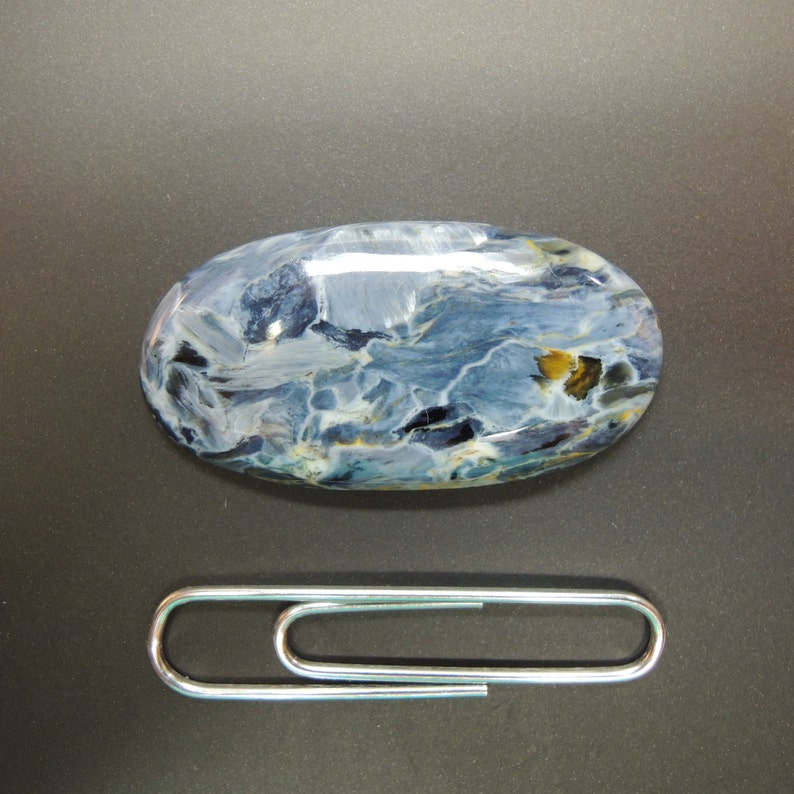 this oblong gemstone 16 x 32 mm blue ocean of Namibia weighs 13.66 carats Pietersite cabochon oval elongated with seascape