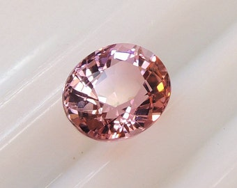 Bright pink oval tourmaline, brilliant oval cut gemstone candy pink, a hint of orange, Africa, 1 69ct 6.4 x 7.6 mm