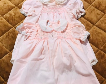 and front design. pink hand smock top vintage dress of quality An adorable little baby girl very decorative lace collar puff sleeves