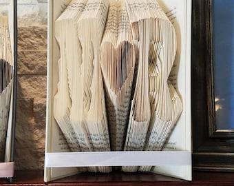 Initial folded book art