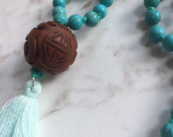 Turquoise and Wood Mala:  Hand knotted with Tassel