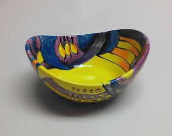 """Hand painted ceramic """"swoop"""" bowl with yellows, oranges and blues"""