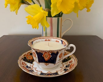 Tuscan China England c1935 gold gilt fine bone china tea cup and saucer in Imari style with lavender and geranium oil scented soy wax candle