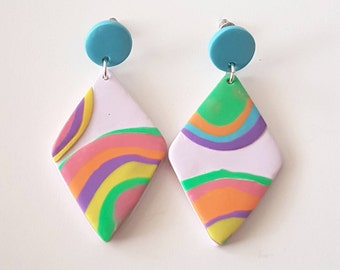 Gobstopper. Diamond shaped lavender rainbow statement earrings.