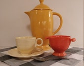 Original 1940s Fiesta cup and saucer and sugar bowl in classic 1940s Fiesta colors old ivory and Fiesta red.