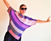 Fashionable crocheted asymmetric lilac pullover. Striped women 39 s warm tunic. Sweater with oblique purple and pink stripes.