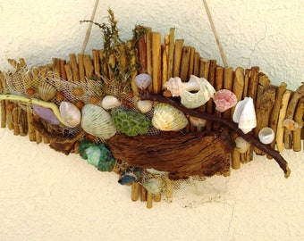 Natural panel made of sea shells and wooden sticks