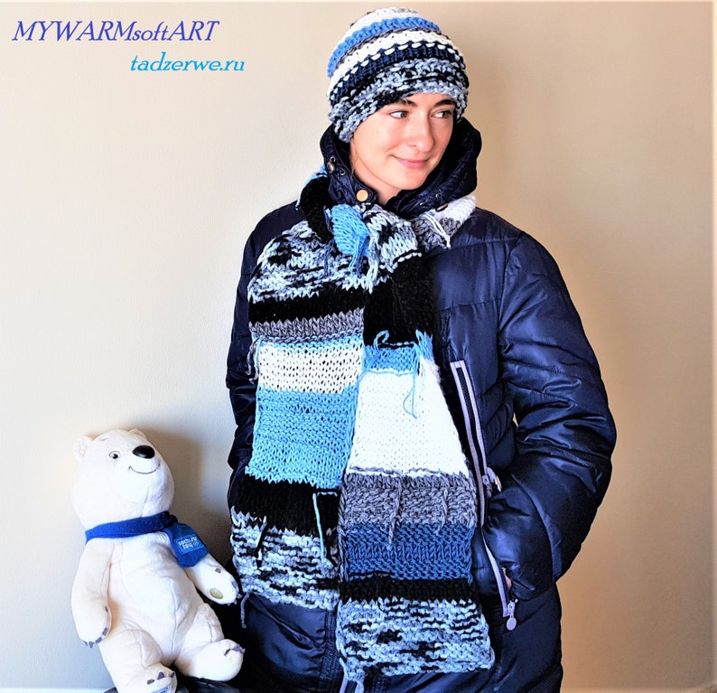striped Knitted \u0440attern Hippie Set: A long White-blue- black scarf and hat. hand-knitted scarf and a striped hat with a fringe