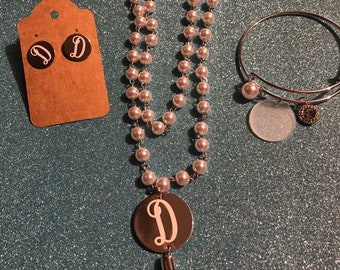 Monogram jewelry set. 1 Necklace, 1 bangle bracelet and 1 pair of earrings.