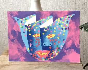 Illustration of a cheerful and colorful carnival face or mask with confetti in pink blue tones