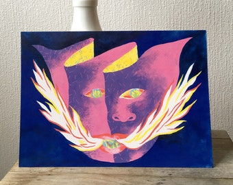 Painting a mask with a fire-breathing mouth and a colorful face on a dark blue plain background