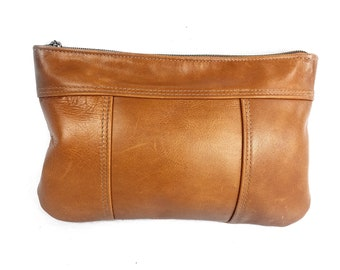 Light brown, caramel, or whiskey  coloured leather clutch for summer for day and evening