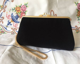 Black velvet evening clutch purse bag with gold coloured metal kisslock frame