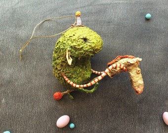 OOAK Lime punch Monster with a Horse on a Stick. Original Christmas ornaments designed to hang on a tree.Handmade and hand-painted.