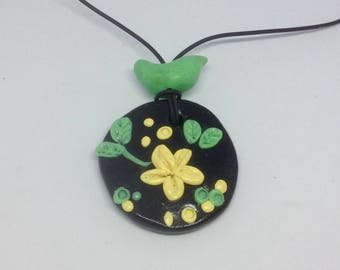 Clay bird and flowers pendant
